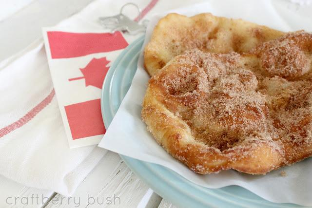 This delicious fried dough dessert is also known as  beaver tails* and it's  an Oh so Canadian pastry made of flour that is deep fried and usually topped with sugar and cinnamon.  There are many variations of other delectable toppings such as chocolate, hazelnut and strawberries.