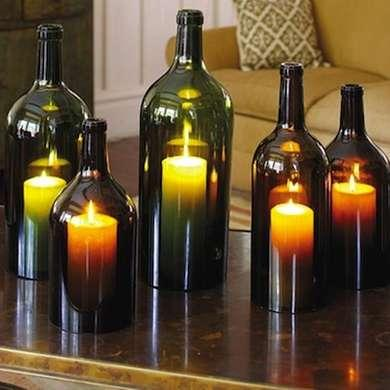 Wine Bottle Hurricane Lamps  How's this for a simple yet charming candle assortment? Just slice the bottom off three wine bottles of different shapes and sizes, and pop each one over a tea light. Group them together on a mantel or tabletop for a flexible, easy-to-make centerpiece.