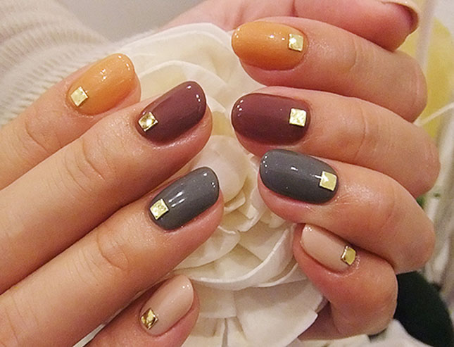 so simple paint a nail a color and add a stud simple but cute