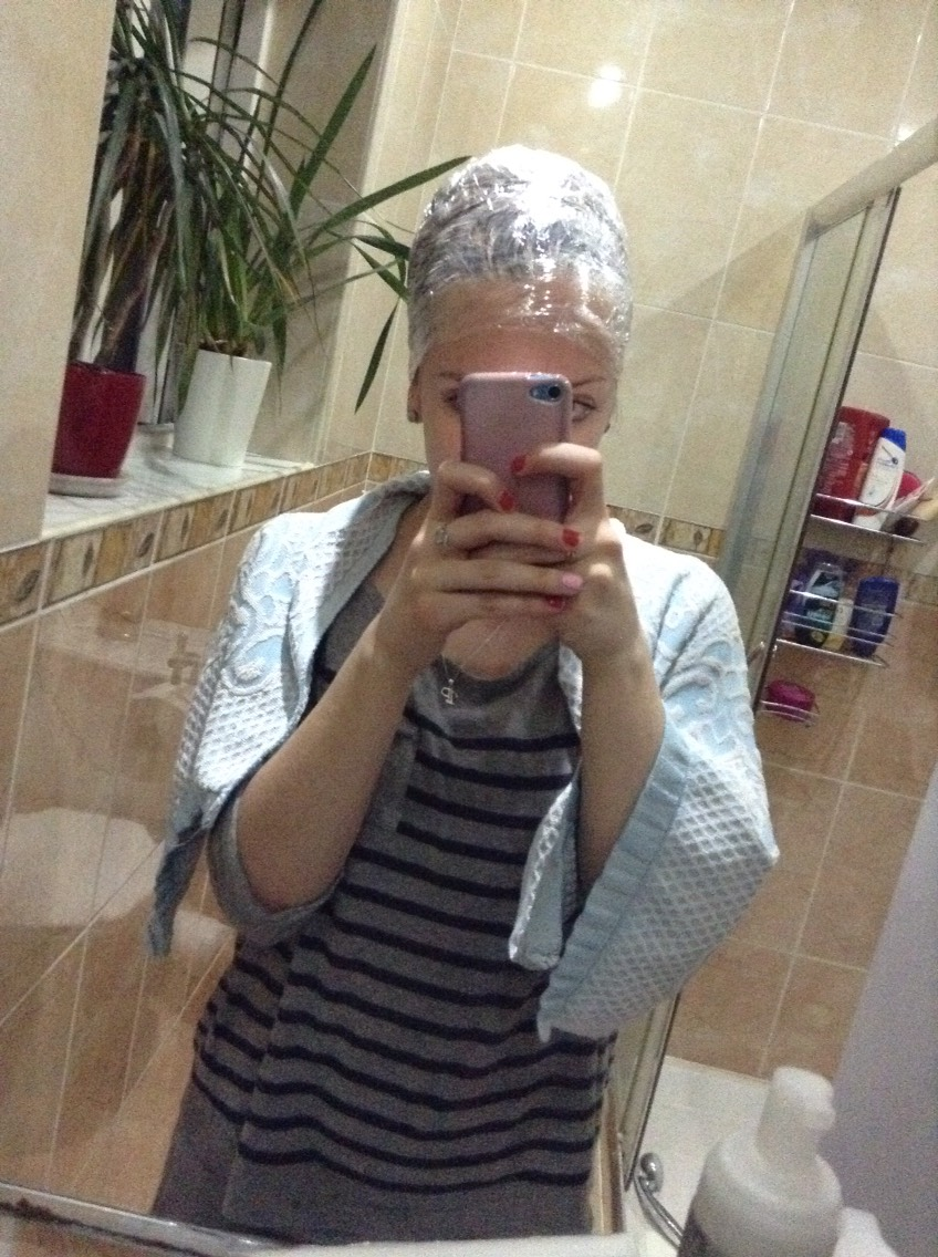 Step Eleven. Cover your hair in cling film. It traps the heat and helps the mixture to work faster.