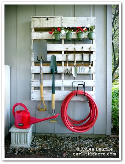 Use an old pallet for storage to hang tools, equipment or anything needed.