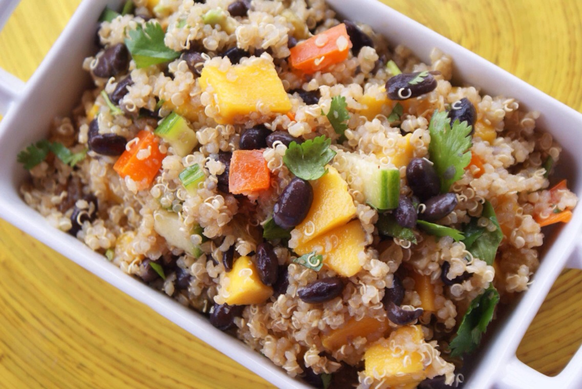 Quinoa and Fruit  Power up your wind down with this supercharged curried quinoa salad. Featuring fiber- and protein-rich quinoa and black beans, with the added tang of mango, this is hearty salad that won't weigh you down.