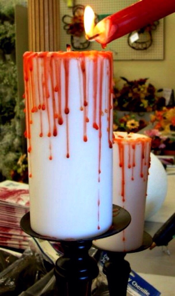"Use a red candle to drip ""blood"" over a white candle"