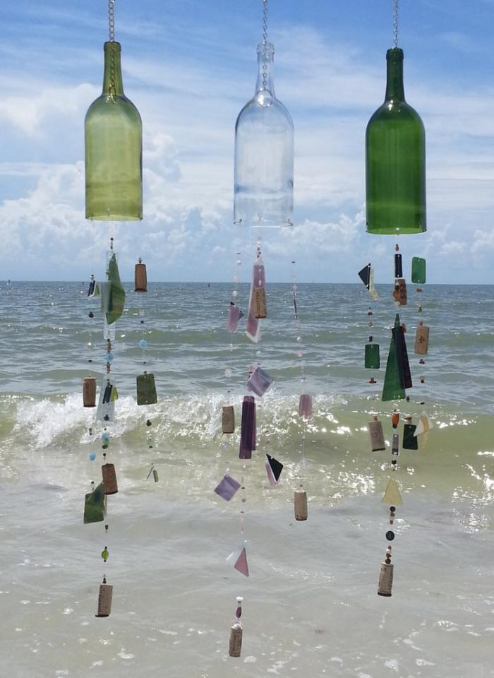 Wind Chimes Modified wine bottles, when strung with beautiful pieces of glass, make ornamental wind chimes perfect for inside or out.