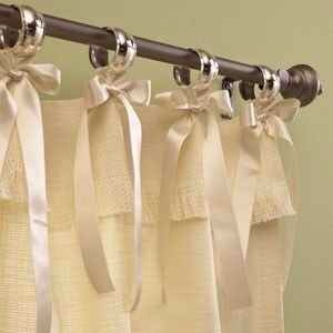 8. Use napkin rings and ribbons to pretty up your shower curtain
