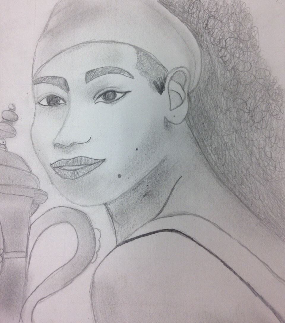 This is a drawing that I drew in Talented art class and we were working on drawing using a grid that is on a different photo and try and draw what he have in each box