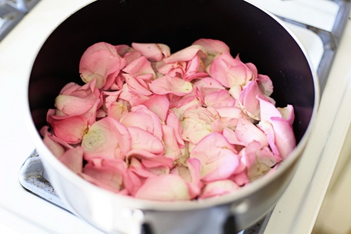 Pour the rosewater into each of the ice molds, then add in rose petals, and finish with water. Place molds in freezer and freeze until solid. When ready for your facial treatment, boil some water and pour into a large bowl. Place your face over the steaming bowl with a towel over your head for 1-2 minutes.