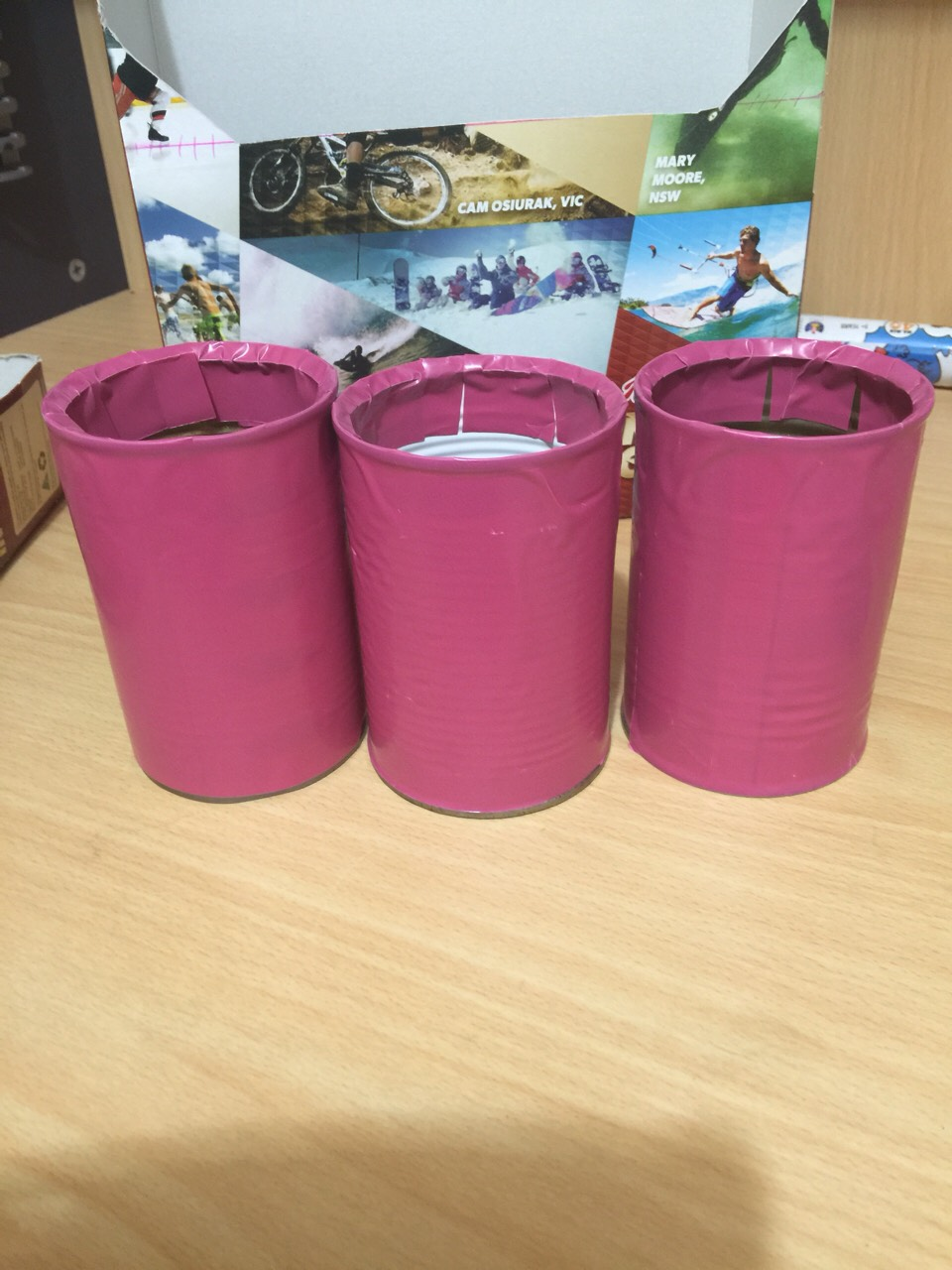 Now cover the cans as you wish. My daughter loves pink. So I made them pink.