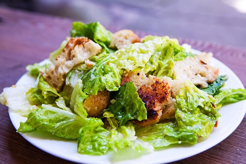 2. Chicken Caesar Salad (Dinner-size portion) 900 calories  60 g fat   Eat this instead!  Grilled chicken on mixed greens 400 calories  20 g fat