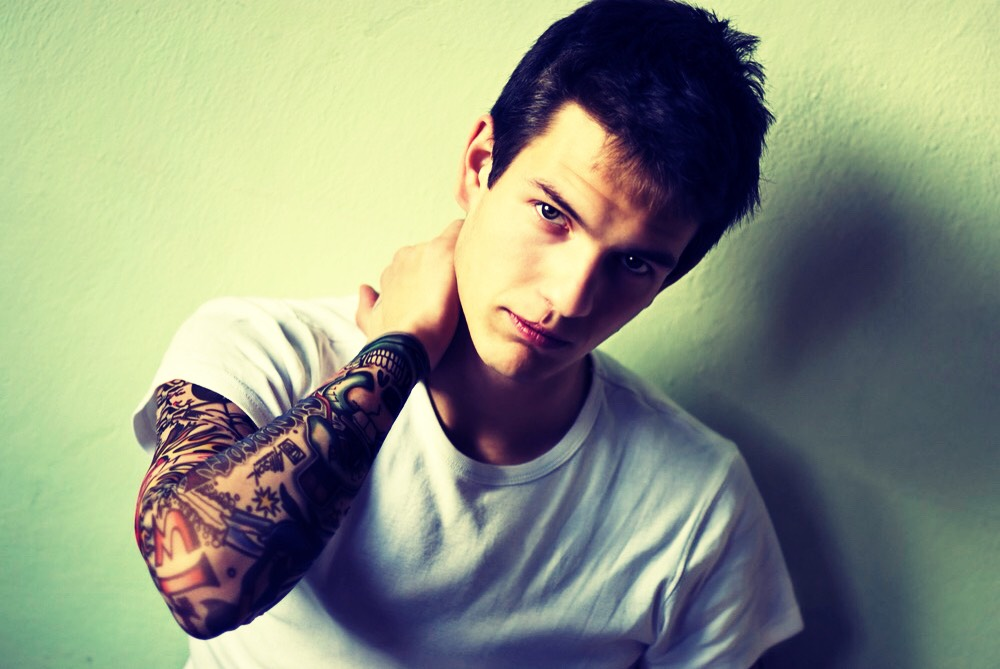 HE'S AN ARTIST:  If he expresses himself with tattoos, he definitely has an artistic side. Many a sleeved-up guy is also an artist of some kind.  And he might also play the guitar… which, let's face it, is a complete panty-dropper no matter how old you are.