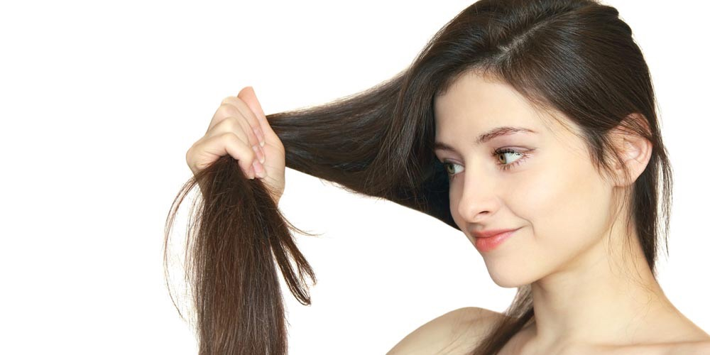 Get your hair trimmed every 6 weeks, this gives it time to grow between trims and also gets rid of any unwanted split ends
