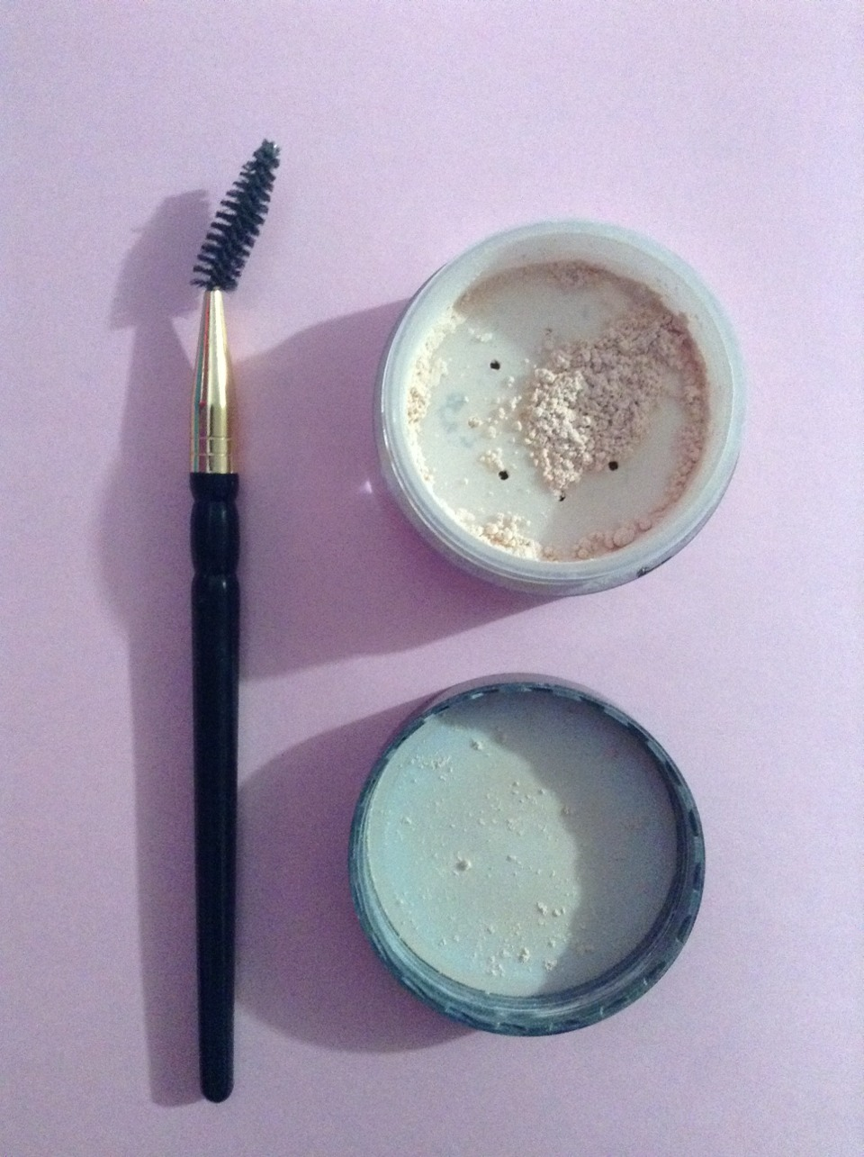 You will need a spooley brush and some translucent powder.