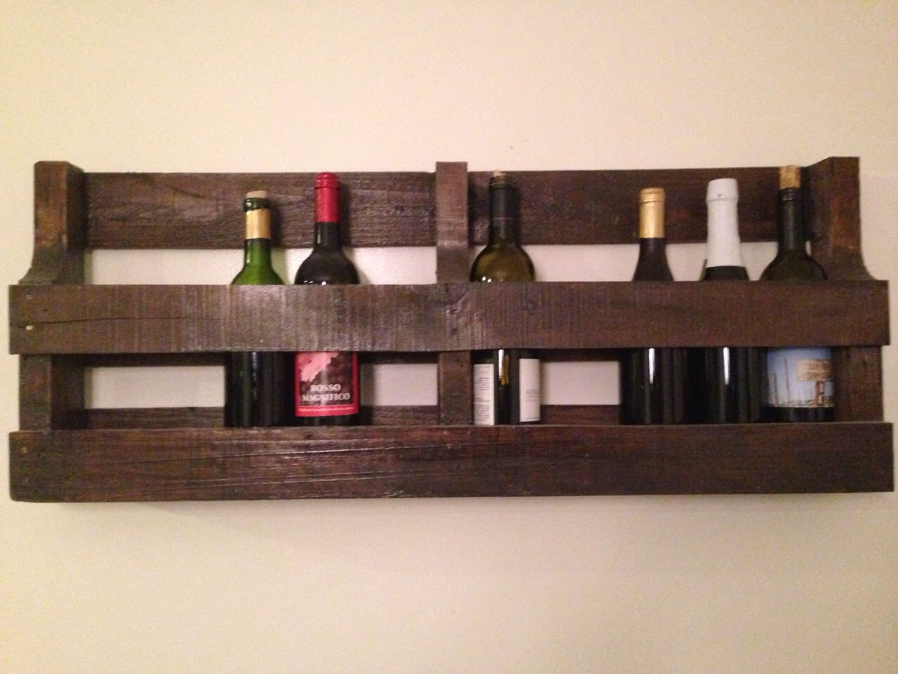 Pallet wine rack! This took me just a few hours total and I get sooo many compliments! Really makes our dining area unique
