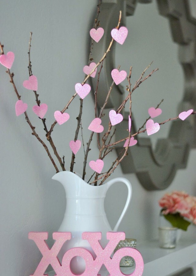 Get branches and twigs and hot glue paper hearts onto the sticks. Super easy and so cute!