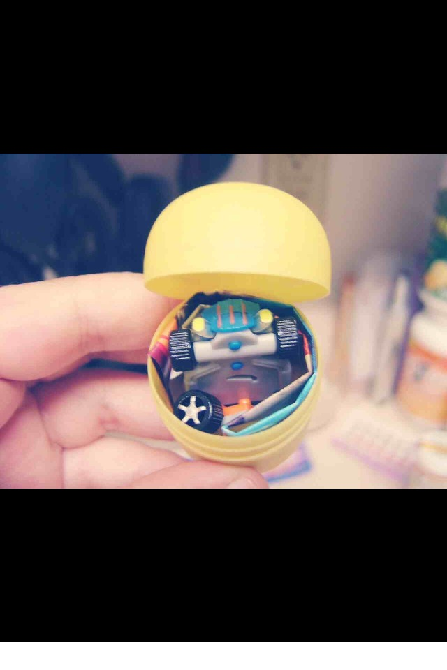 Take the egg of the kinder egg and pour the melted Vaseline half way. It MUST be half way.