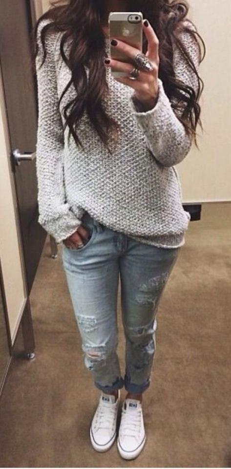19. Chunky Knit Sweater With Ripped Skinnies