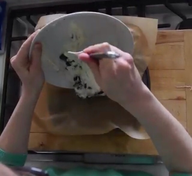 Scrape the mixture into a pan that's covered with wax paper
