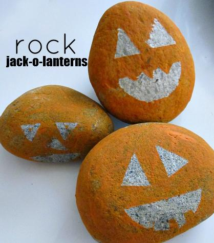 19. Painted Rock-o-Lanterns  Add some glow-in-the-dark paint if you want the eyes to glow justly in the yard.