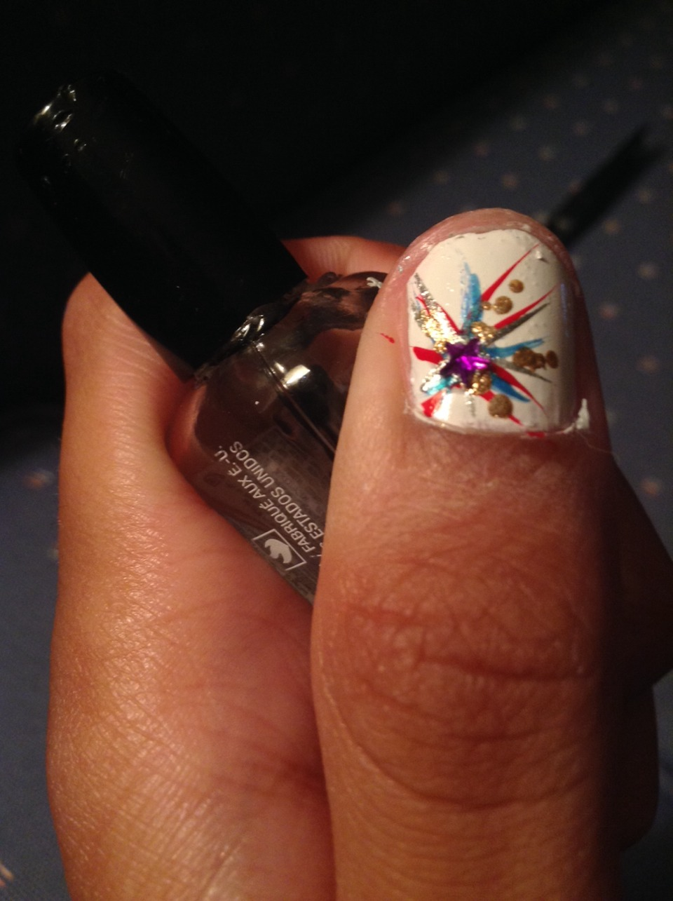 Optional: put clear polish at the center of the firework and put a gem in the middle. I chose a purple star. Make sure to put extra top coat over the gem to make it stay on. 💜🌟