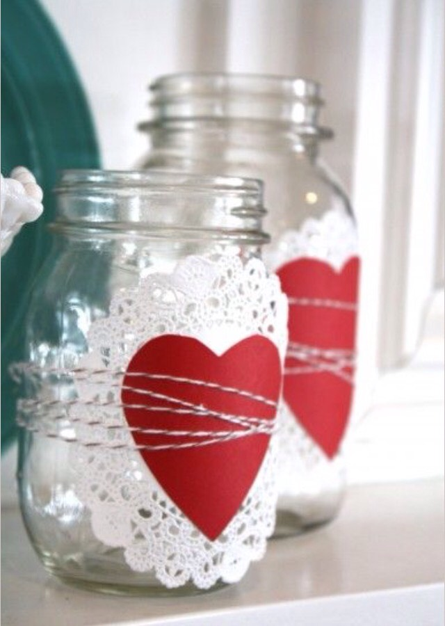 Get a mason jar, a circular piece of lace and a felt heart, attach together with string or  hot glue.
