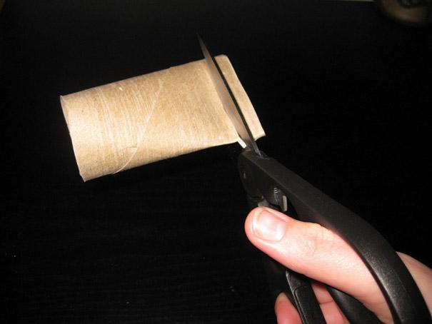 cut thin strips from a toilet paper roll