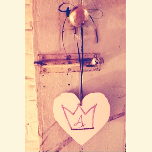 Cute heart decoration for door handle made with scrap wood paint, sequins and ribbon!