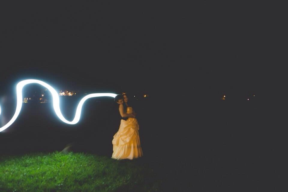 Groom holding bride, camera light going around. KEEP IN MIND THESE SHOTS TOOK US AN HOUR TO DO (night time ones)
