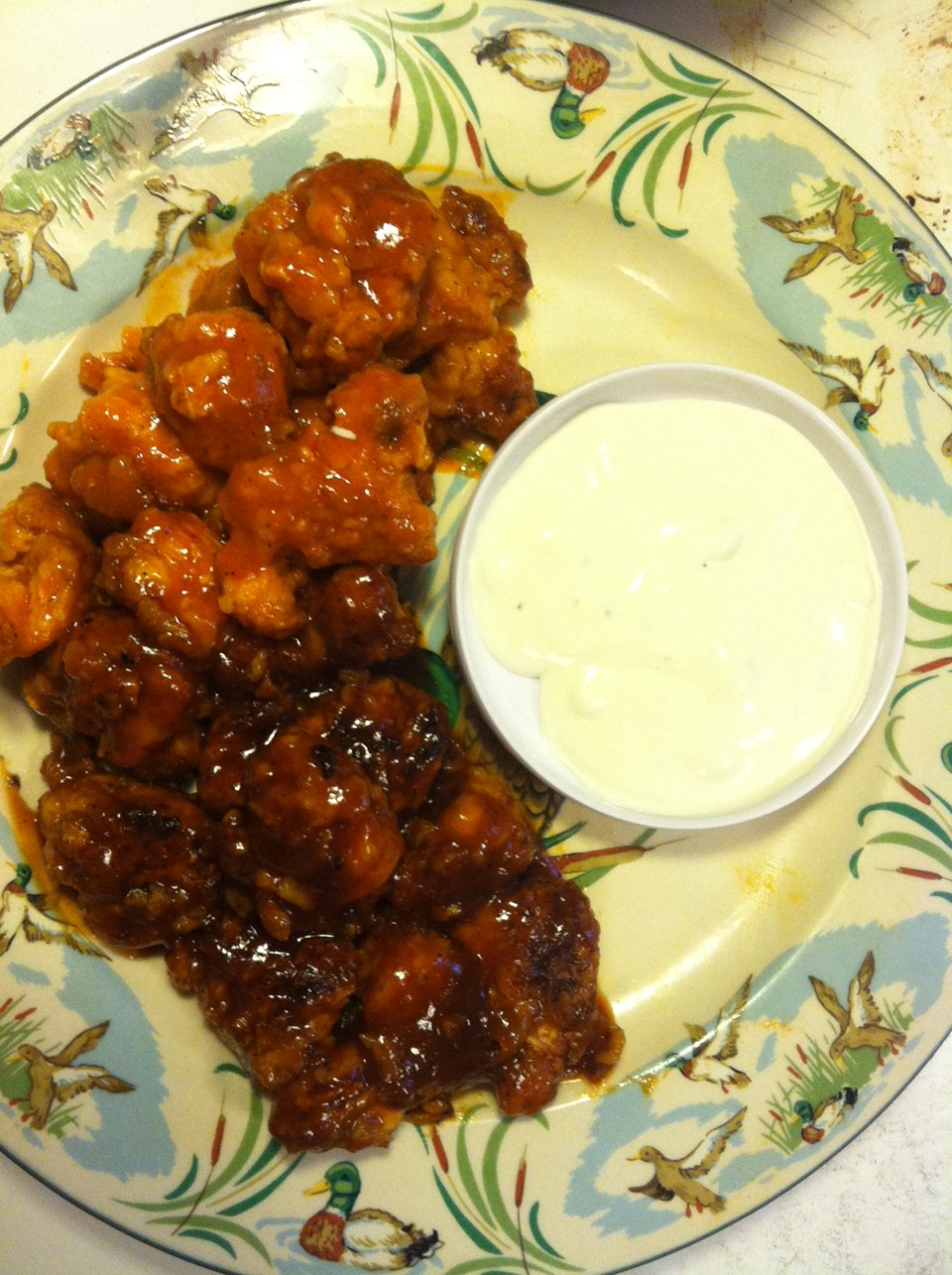 Toss chicken in sauce till evenly coated, transfer to plate, serve with your favorite dipping sauce and some celery. Enjoy!