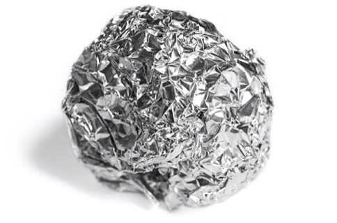 Next, crumple the aluminum foil in a ball like so,