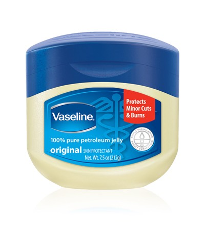 Put a small amount of Vaseline (or any petroleum jelly) to the areas you want to apply your perfume. You want a thin layer not a thick one that will look shiny and feel greasy on your skin.