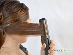 Fold the hair forward. Now, either glide the iron down your hair or just release it and move it down 2-3 inches (5 - 7.6 cm) before you fold it forward, in the opposite direction that you folded it the last time.