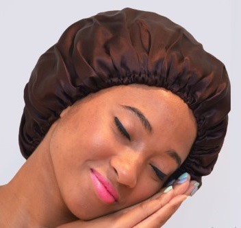 Wrap your hair at night, and sleep with a silk/satin bonnet. (Silk/satin pillow case will also do the trick!)