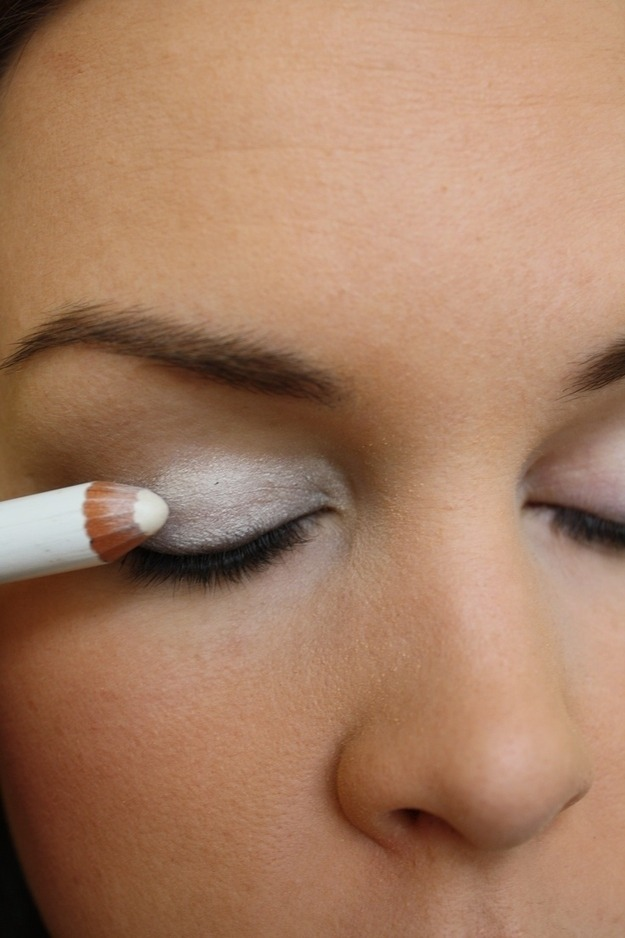 Color your entire lid with white eyeliner to make eyeshadow colors POP.