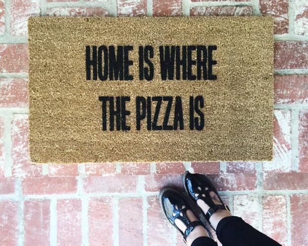 21. A doormat featuring the true definition of home.