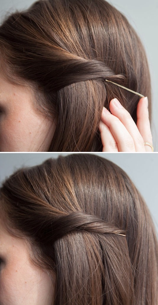 4.Twist your hair, & slip your bobby pin underneath to discreetly pin back your strands.  Insert a b-pin with the open end pointing toward your facein the opposite direction of the section you're pinning back. If 1isn't strong enough, try using a larger one/reinforce it with a 2nd pin right below.
