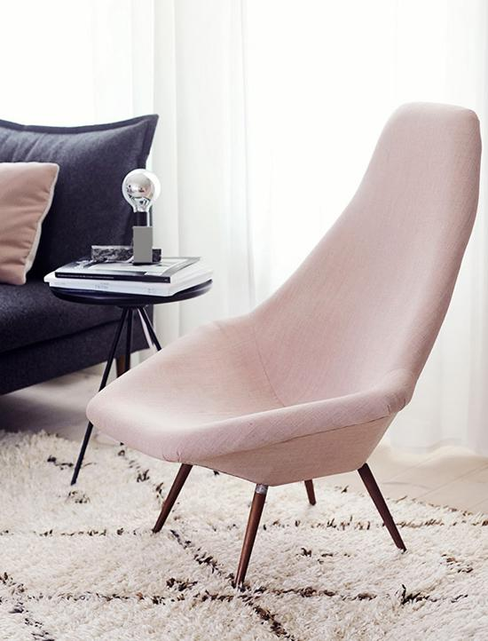 Try an accent chair in rose quartz that doesn't overpower the room.