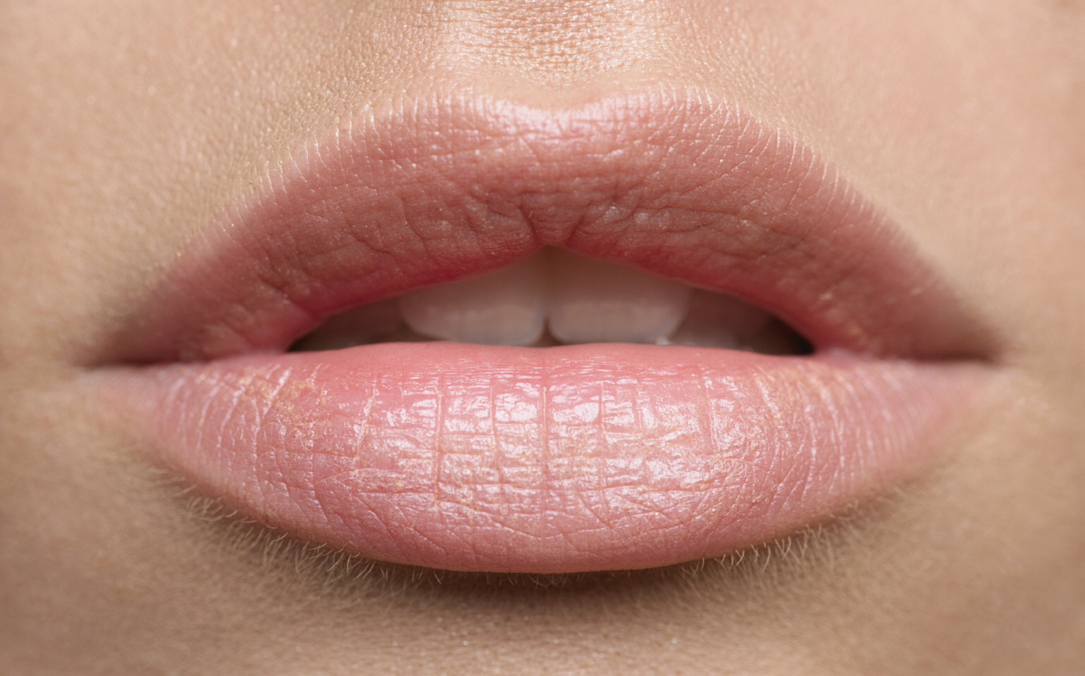 Put cheek or eye highlighter fully around the outside of the lips before applying lip liner or lipstick