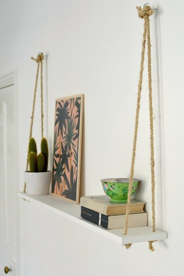 Tie a sisal rope onto a painted board to create a hanging shelf.