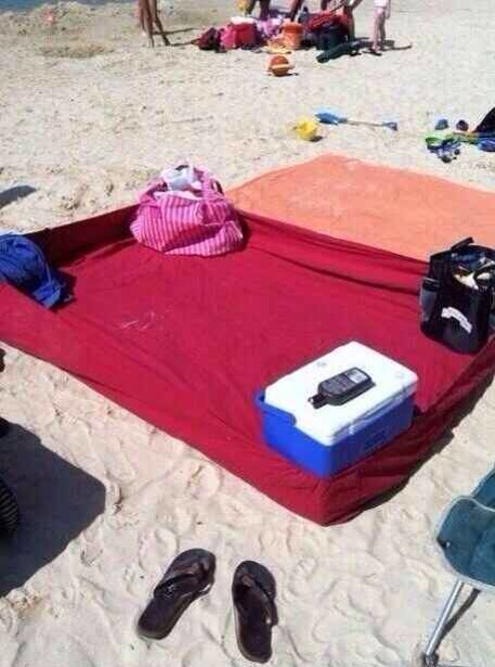 Use a fitted sheet on the beach to keep sand out.