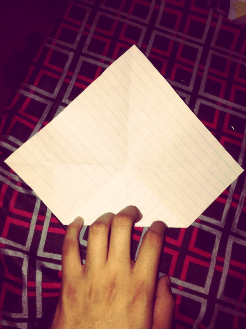 4) Grab each corner and fold them to the center. Use the lines as a little outline to keep a bit straighter.