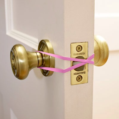 Rubber Band Door Stop Use a rubber band to prevent your door from latching when going in and out frequently.