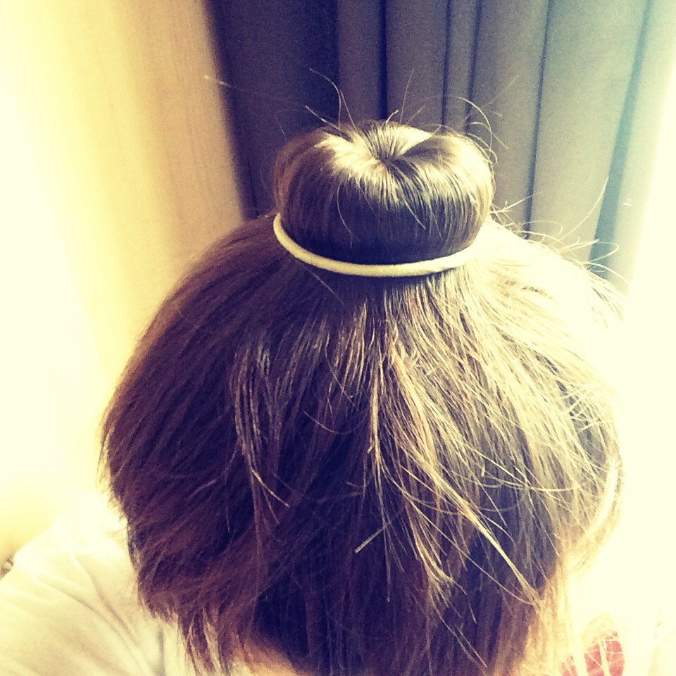 Put a hair tie around the bun to keep the hair stationary