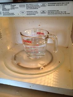 Put one cup of water and one cup of vinegar in a microwaveable bowl or cup