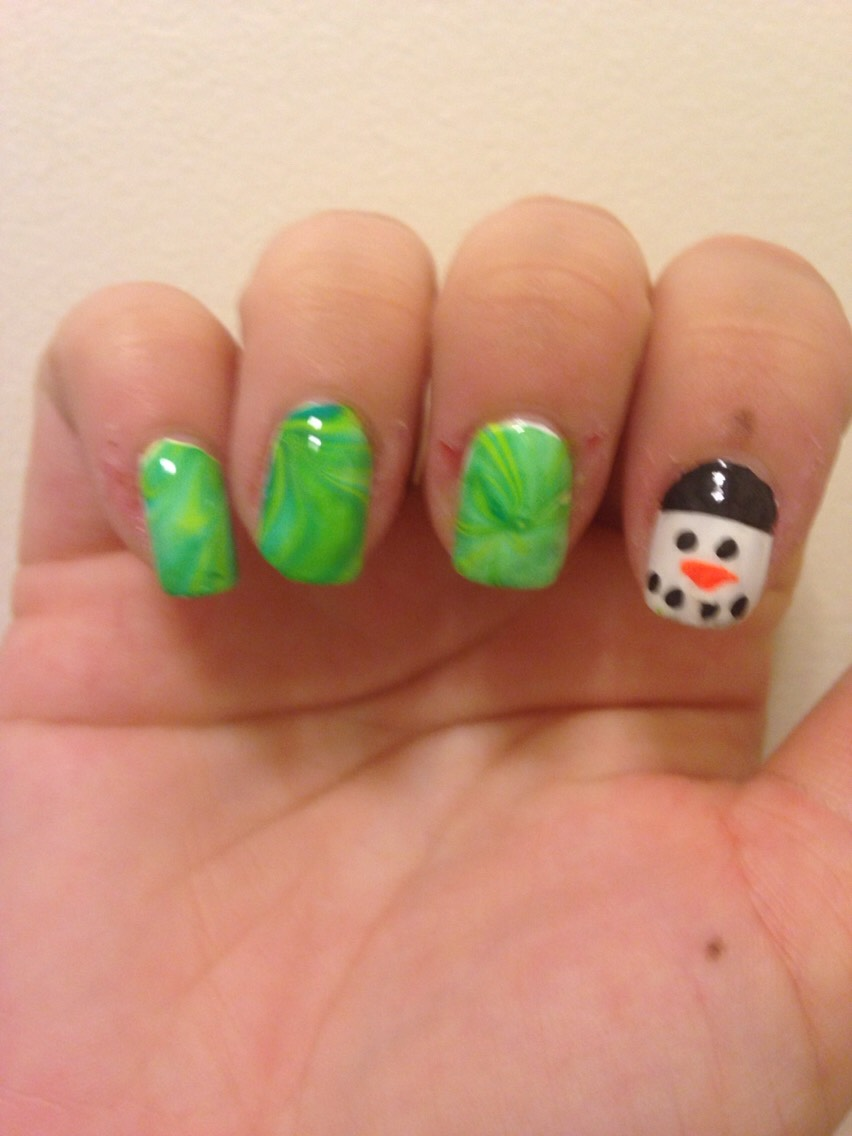 Green water marble nails with snowman accent nail