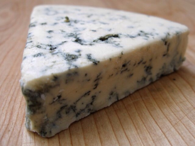 And finally blue cheese (I add it for the flavor it's not really needed though.) just add a few crumbles of the blue cheese and let the whole mixture cook for 5-10 minutes.