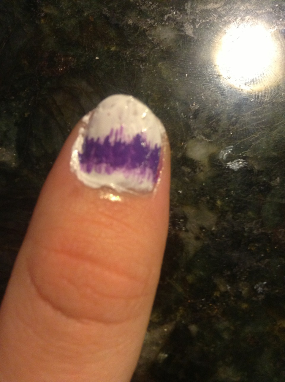 Step 6: Continue down the line of polishes making small stripes onto your nail
