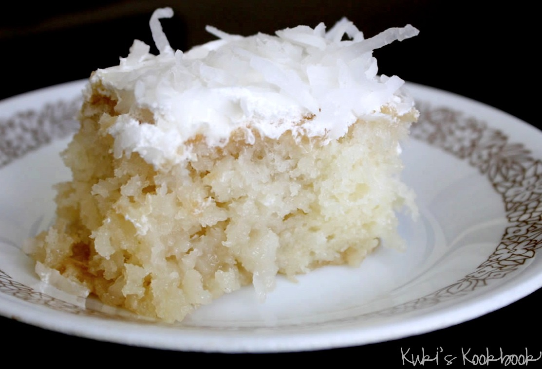 INGREDIENTS:   1 Box of White Cake Mix 1 Can of Coconut Milk / Cream of Coconut 1 Can of Sweetened Condensed Milk 1 Bag of Coconut Flakes  1 Can of Whipped Cream