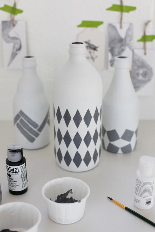 2. Paint empty glass bottles for modern vases.