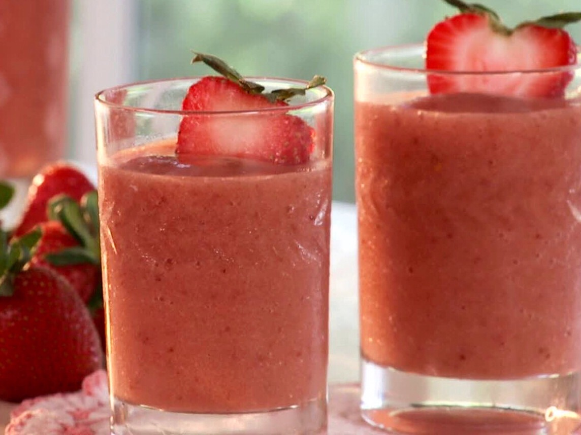 Tropical Fruit Smoothie: 1 mango (peeled and seeded) 1 papaya (peeled and seeded) 1/2 cup strawberries  1/3 cup orange juice 5 cubes of ice