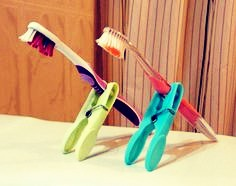 If you want to keep your toothbrush upright, use a clothespin.